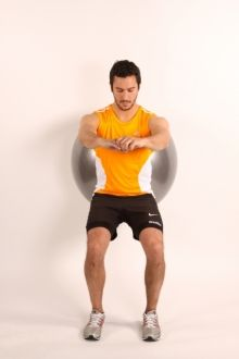 Swiss Ball Squat front view, maintain knees over ankles (2nd toe) throughout the movement.