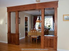 Vintage Custom Cabinetry made this Craftsman style oak colonnade.
