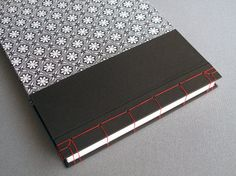 "IONA BINDING - Handmade photo album measures 14,17"" x 10,23"". Covered with paper that has been handmade and screen printed in Nepal and brown fabric."