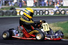Ayrton in his kart with the legendary yellow helmet.