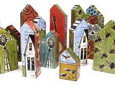 """Lisa Kesler's """"houses"""" made from a solid block of wood, left over from various construction sites. Kesler hand-printed linoleum block images on each side of the pieces.  Gloucestershire Resource Centre  http://www.grcltd.org/scrapstore/"""