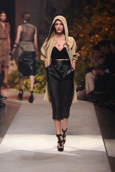Oro Suede Parka.  Black Napa and Tulle Bra Top.  Black Woven Napa Skirt.  Black Leather Sandal Woven Wedge.