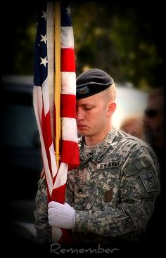 United States Army soldier holding his flag during a Memorial Day ceremony
