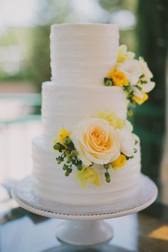 White Wedding Cakes Just a touch of sunshine on this traditional white wedding cake for a summer wedding. - Flowers are in and sure can be the perfect decoration for gorgeous wedding cakes, as you soon will find out. Plain Wedding Cakes, Wedding Cake Fresh Flowers, Elegant Wedding Cakes, Beautiful Wedding Cakes, Wedding Cake Designs, Wedding Cake Toppers, Beautiful Cakes, Yellow Wedding Cakes, Trendy Wedding
