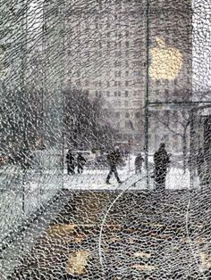 "via BuzzFeed: ""Apple's Iconic New York City ""Cube"" Store Shattered During Snowstorm""."