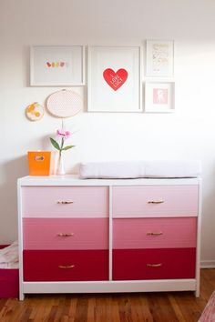 click through because this pink nursery is happy and perfect - mostly white with pink accents and pops of orange/yellow.  modern and not frou-frou.