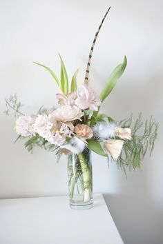 Love this #spring floral arrangement - photo by Natalie Spencer Photography and design by Darling and Daisy http://ruffledblog.com/gilded-romance-valentines-shoot/