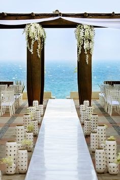 Wow! Amazing destination wedding ceremony at Capella Pedregal Resort in Cabo San Lucas, photo by Chris Plus Lynn  | via junebugweddings.com