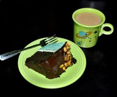 Random Musings of a Deco Lady | Monster of a Chocolate Pistachio Cake ~ two-layer slice of cake plated on chartreuse Fiesta® along with some café au lait served in one of the chartreuse Fiesta® mugs from the American Museum of Natural History