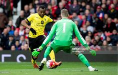 Jordan Ayew of Aston Villa is challenged by David De Gea of Manchester United during the Barclays Premier League match between Manchester United and Aston Villa at Old Trafford on April 16, 2016 in Manchester, England.