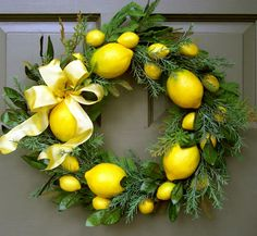 "Faux Lemon Wreath Our Faux Lemon Wreath is a popular choice for any season of the year. Greens mix with bright yellow lemons creating a wreath you'll love to hang on your front door, kitchen door or inside wall. Finished with a lovely yellow bow. 17"" diameter x 5 1/2"" deep"