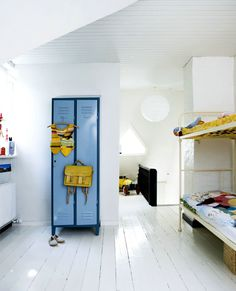 blue locker & white wooden floors
