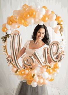 Love this shape for a photo prop instead of the traditional square. Would work with foamcore instead of balloons and the persons name instead of love. Lightweight and unique are keys to photo props. Balloon Wreath, Love Balloon, Balloon Bouquet, Balloon Columns, Balloon Arch, Balloon Frame, Balloon Ideas, Ballon Decorations, Wedding Decorations