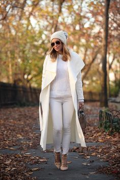 white outfit with cream coat