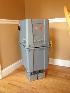 Star Wars themed laundry hamper I made: Gonk Droid! Just got a couple of gray storage bins, laundry duct for legs, tissue boxes painted silver for feet and assorted Joyce and milk tops painted silver for buttons and knobs and some hot glue to make it. Sooo much fun to put together for my Star Wars living daughter!