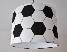 Exclusive, handmade lamp shade made from high-quality materials. Unique in a soccer ball design. The lamp shade fits perfectly into a teenagers room and gives your home an individual touch. Suitable also as a screen for a floor lamp. When purchasing this lamp shade, you get a lamp shade suspension free. (see photo) (lamp hanger for free)  Materials: Abiona lamp film high quality fabric, lamp rings white, metal Height: 22 cm Lampholder: E27