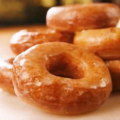 You don't need super sharp culinary skills to make perfect yeast donuts at home—anyone can do it! What you do need is plenty of time, making them the perfect weekend baking project. Donut Glaze Recipes, Easy Donut Recipe, Potato Donut Recipe, Krispy Cream Donuts Recipe, Krispy Kreme Glaze Recipe, Easy Yeast Donut Recipe, Bisquick Donut Recipe, Amish Donuts Recipe, Deep Fried Donut Recipe