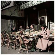Robert Capa - Alla and her dog sitting at Cafe de Flore, Paris, 1952