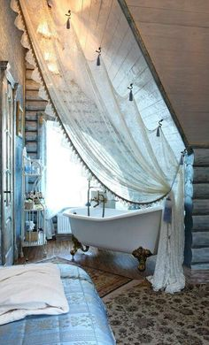 Good idea on the hooked curtain on a slant ceiling~ By the bed for room darkening on the slant side?
