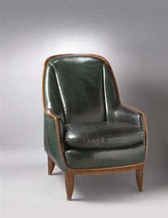 EMILE-JACQUES RUHLMANN (1879-1933). A 'BOUDOIR REDHEAD' BERGERE, CIRCA 1928 In Rio rosewood veneer, upholstered in green leather The model was exhibited at the Salon des Artistes Décorateurs in Paris in 1928.