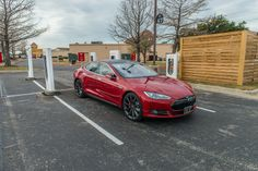 Tesla Model S, red brake calipers at supercharger. For more, check out: www.evannex.com