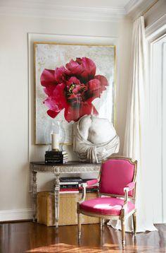 Love the flower art and fuchsia chair