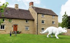 A Cotswolds cottage feels like a film set to its occupants, an artist and his   family – complete with extras from his Jurassic period