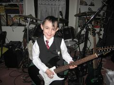 This is my youngest son Kameron, He loves to play the guitar and also the drums,He has a ear for music just like his father. #MusicallyGrown
