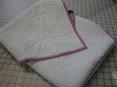 How to Fold and Store Quilts!  All quilts should be folded on the bias.