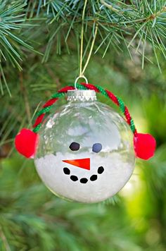 Christmas Snowman Ornament Craft Made With Clear Glass Balls. We love this simple craft idea!