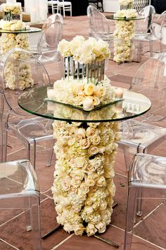 How incredible is this floral table base.  Maybe just for the cake table or for the guest book...