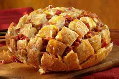 Bacon Cheddar Pull-Apart Bread8 oz of your favorite shredded cheddar cheese blend.1 large round loaf of soft bread (like a French or Italian round)8 oz. diced sliced bacon, cooked crisp1/2 cup melted butter1 Tablespoon dry Ranch dressing mix from packetCut bread in 3/4-inch intervals, being careful to not cut all the way through. Cut again, crosswise, not cutting all the way through. Place cheese in between all cuts: sprinkle with bacon. Blend melted butter and Ranch mix and drizzle over top…