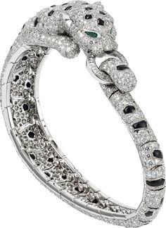 CARTIER. Bracelet - platinum, 981 brilliant-cut diamonds totaling 12.70 carats, emeralds, onyx. #Cartier #CartierRoyal #2014 #HauteJoaillerie #HighJewellery #FineJewelry #Emerald #Onyx #Diamond