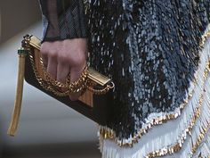 gold plated clutch black gold and white sequined dress
