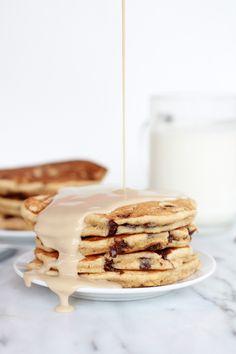 whole wheat chocolate chip banana bread pancakes with vanilla coconut glaze