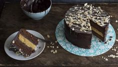 This cake is exceptionally rich and chocolatey. One for the grown-ups! For this recipe you will need an electric mixer, a disposable piping bag and 3 x 20cm/8in round cake tins.
