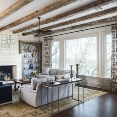 These beautiful Hand Hewn beams were sawn on one side in order to provide a flat surface to mount. The beams offer some rustic charm to this traditional home. White Ceiling, Ceiling Beams, Hand Hewn Beams, Faux Wood Beams, Rustic Decor, Rustic Charm, White Oak Wood, Beautiful Home Designs, Whitewash Wood