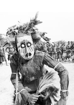 Africa | Pwoom Itok mask dancer. Muentshi, Democratic Republic of Congo. 1972 | One encounters this type of mask among various Kuba group, including the Bushoong and the Ngeende. It appears during the young men's initiation and also performs as a dance mask. | ©Eliot Elisofon