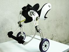 amigo dog wheelchair.  This custom-made device is attached to the hips and enables small dogs with disabled rear legs to move with absolute ease. Compared to other dog wheelchairs, this one is way better because of dynamic design and more independent moving supports. The elastic knee joints are set backwards, allowing the dogs to use the staircase, sit up and lay down all by themselves.