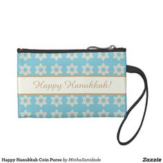 "Perfect customisable Hanukkah gift. Beautiful coin purse in blue, white and gold, decorated with the star of Davi pattern and a ribbon where in one side you have the message ""Happy Hanukkah"" and the other side ""A great miracle happened there!"" - both messages can be changed to whatever message you like on the product page."