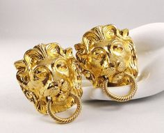 Vintage Adventure Buy It Now listing ends June 7. 2014. Vintage lion head doorknocker belt buckles by designer Mimi di N. Substantial gold tone buckles, stamped 1974 Mimi di N, fit 1 1/4 inch (35 mm) wide belts.