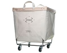 pricing begins at $63.65 from Steele Canvas/still dreaming of this industrial laundry cart, Remodelista