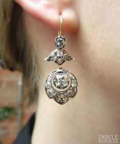 Antique diamond bellflower earrings in silver topped gold, from Doyle & Doyle. #AntiqueJewelry
