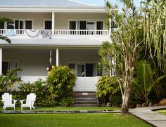 Grass, palms, white adirondack chairs & balcony upstairs for Cottesloe sunsets
