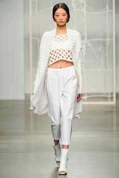 Crochet on crochet -- in addition to all the knitwear on the model, take a peek at the backdrop for the runway -- yup, it's crocheted! Tess Giberson Sp14 RTW NYFW