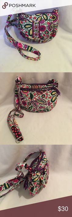 "New without tags Vera Bradley bag Colorful vibrant Never used Vera Bradley bag with adjustable strap and zipper closure- 2 inside slip pockets , outside zipper back pocket and front pocket with slip pocket.  9"" across 8"" height 24"" strap drop at its longest 2"" deep Vera Bradley Bags Shoulder Bags"