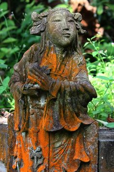 Chinese garden statue. Love the colours that have formed on her.