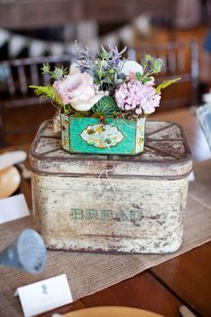 (Use vintage metal or wooden boxes to gain height on your tables)   Rancho Santa Fe Wedding by Bryan N. Miller Photography