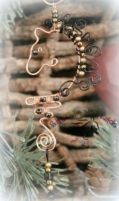 ~Wired Whinnies ~ by Rhythm-n-Beads TM  are  whimsical  copper wire horse Suncatchers....lovingly hand fashioned  from copper wire and accented with beads & charms. Hang your 'wired whinnies' ... * in a window *from a rear view mirror * from a lamp * in the tack room * on the Christmas tree or a wreath during the holidays, or......the possibilities are endless :) Wire Horse Suncatchers, Rearview Mirror Dangles, Horse Ornaments www.rhythm-n-beads.com www.facebook.com/rhythmbeads
