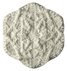 Knit snowflake pattern. This would be beautiful incorporated into the ends of scarves.